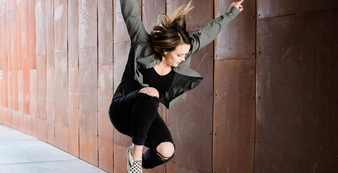 Photo of Maricopa Community Colleges dance student jumping in the air