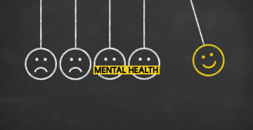 Image of five smiley faces and the words mental health in yellow