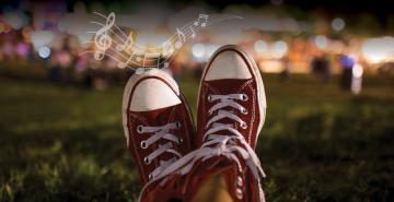 "Photo of shoes on a lawn with the words ""Music under the Stars"""